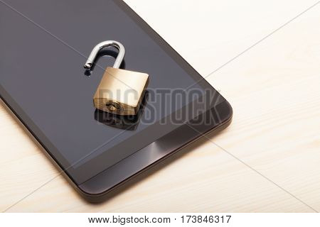 Smartphone With A Small Unlocked Lock. Mobile Phone Security And Data Protection Concept