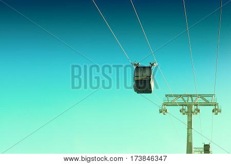 Cable car in ski resort going up in early morning