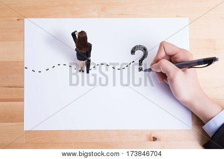 back view of business woman stand on paper look and think about complicated questions