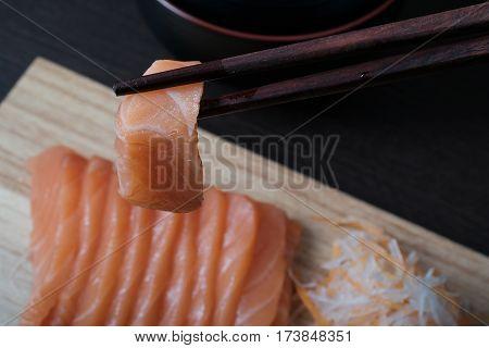 Closeup Chopsticks Raw Salmon Sashimi
