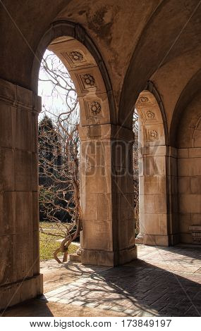 Arches of a beautiful Loggia in a formal garden