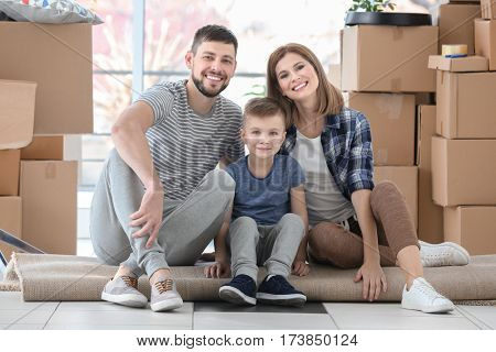 Young family sitting on the floor of new home