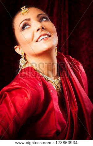 Studio shot of young woman wearing bollywood-style sari