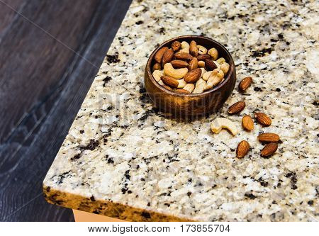 Nuts Concept, Assorted Nuts, Nuts on kitchen countertop, Yellow and brown nuts, Different types of nuts,