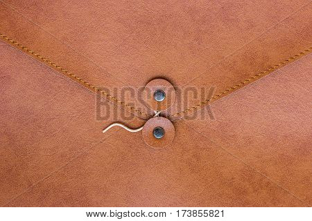 close up of brown leather case document