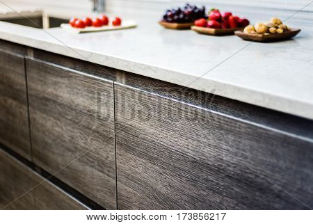 Cabinet of kitchen. Brown kitchen cabinets. Modern kitchen cabinets. Cabinet made of wood. Wooden cabinets. Kitchen cabinet with granite counter. USA cabinetry.