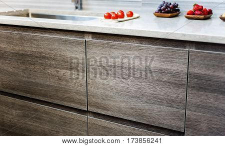 Modern kitchen cabinets. Brown cabinets. Kitchen and bathroom cabinet selection. Cabinet concept. Wooden modern kitchen cabinet.
