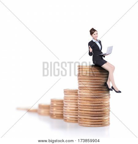 business woman sit on money stairs and thumb up isolated over the white background