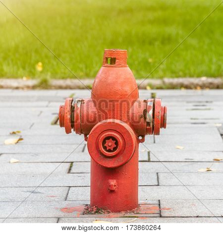 Red Fire Hydrant On Street in city of China.