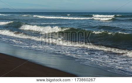 Khalaktyrsky beach with black sand. Pacific Ocean washes the Kamchatka Peninsula.