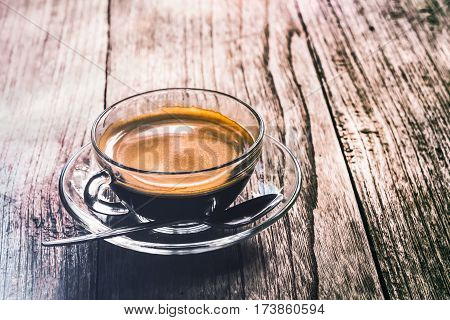 Strong coffee on the wooden background. Fresh coffee. Coffee in cup. Cappuccino coffee. Mocha coffee. Espresso coffee. Latte coffee. Coffee on table. Hot coffee. Coffee beans. Vintage coffee. Morning coffee. Strong coffee. Worm coffee.