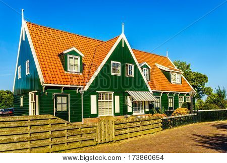 Townhouse complex built in the traditional style of houses of the small historic fishing village of Marken in the Netherlands