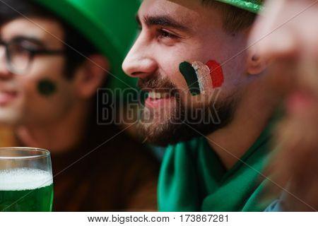 Smiley guy with symbol of irish flag on cheek