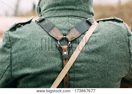 Belts on uniforms and outfits on the back of a German soldier during the Second World War