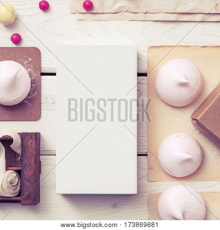 White box mockup between different sweets on the table and figures