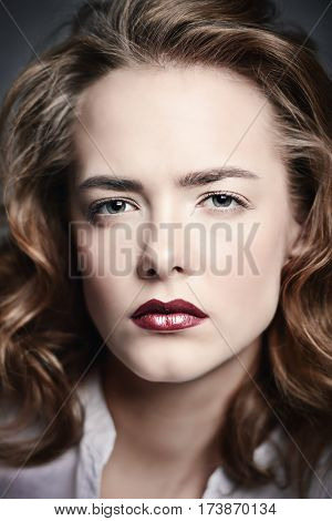 Make-up, cosmetics concept. Exciting young woman with beautiful foxy hair and sensual red lips. Beauty, fashion concept.