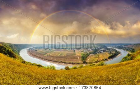 Fantastic view of the sinuous river flowing through mountains. Picturesque and gorgeous scene. Location place Dnister canyon, Ukraine, Europe. Instagram toning effect. Discover the world of beauty.