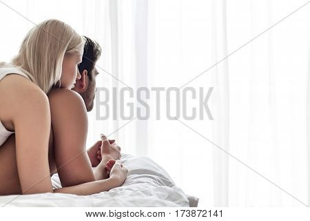 Young couple spending quality time in bed