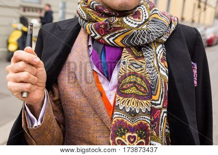 MILAN ITALY - FEBRUARY 23: Detail of a fashionable man outside Fendi fashion show during Milan Women's Fashion Week on FEBRUARY 23 2017 in Milan.