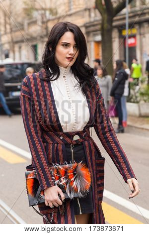 MILAN ITALY - FEBRUARY 23: Fashionable woman poses outside Fendi fashion show during Milan Women's Fashion Week on FEBRUARY 23 2017 in Milan.