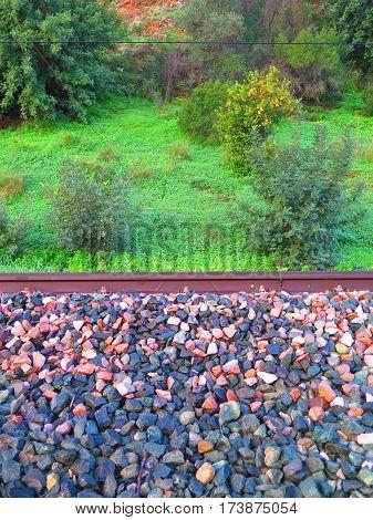Closeup of railway ballast on sunny day in Spain