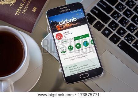 Chiang Mai,Thailand - March 1, 2017: Smartphone Samsung Galaxy S6 open apps airbnb application on the screen on the desk.