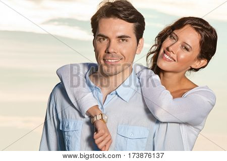 Portrait of loving couple smiling together at beach