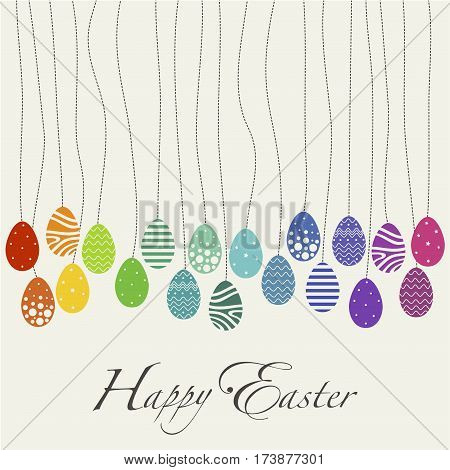 Cover design day cards happy Easter. Depicts a lot of eggs with various ornaments rainbow colors and the phrase happy easter in black on a beige background.
