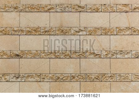 Antic tile. The close up of the wall with vintage beige tile.