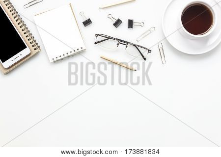 Top view accessories office desk concept.mobile phone coffee notepaper pen on office desk.