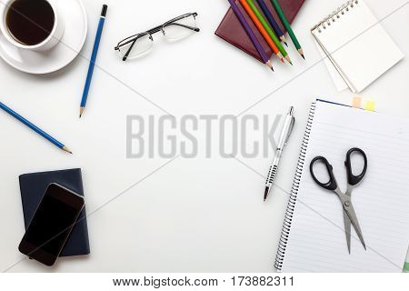 Top view business accessories office desk on white background.
