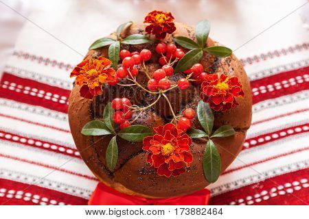 Traditional wedding Ukrainian bread Korovai with flowersWedding round loaf with decoration. Traditional wedding bread.Wedding loaf of bread