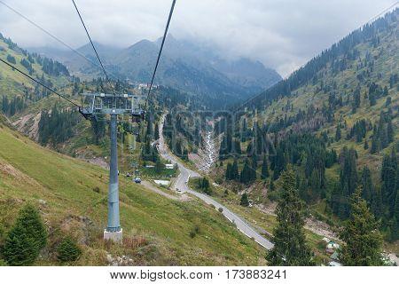 Ropeway in Kazahstan. Ropeway through the hills in Shymbulak Kazakhstan.