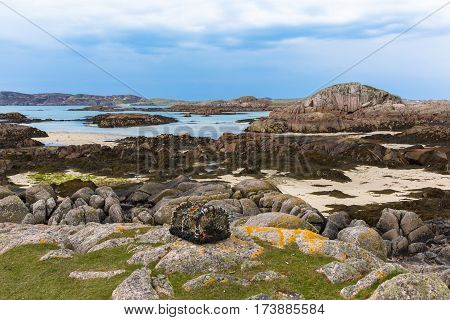 Lobster pot and rocky coast Fidden beach Isle of Mull Scotland uk Inner Hebrides near to Iona and Fionnphort