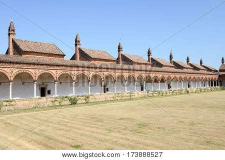 Pavia, Italy - 14 June 2015: Charterhouse of Pavia - Certosa di Pavia Italy. View of a portion of the cloister of the historic abbey. The monastery complex known as Certosa di Pavia is an UNESCO heritage