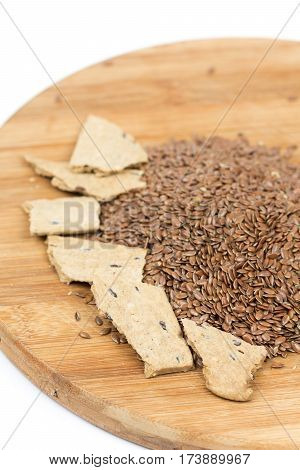 Flax Seeds With Flax Snacks On The Board