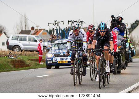 KUURNE BELGIUM - FEBRUARY 26: Luke Rowe (GBR) of Team Sky and Peter Sagan (SVK) of Bora-Hansgrohe racing into the last 2km at Kuurne-Brussel-Kuurne on February 26th 2017 in Belgium