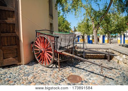 PORT AVENTURA/ SPAIN - MAY 11, 2015. Old wooden wagon with red wheels in the Far West area of theme park Port Aventura in city Salou, Spain.