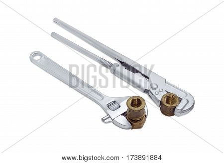 Plumber wrench and adjustable wrench with silvery coating and brass plumbing screw-nut with coupling and pipe coupling on a light background