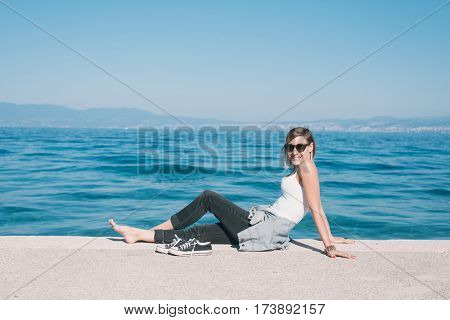 Young adult woman lying on beach