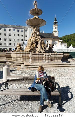 SALZBURG AUSTRIA - APRIL 29 2016: Baroque Residence fountain on Residentplatz in Salzburg. Austria