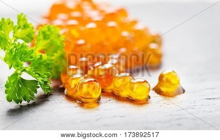 Salmon ROE caviar bead Board with parsley on Slate
