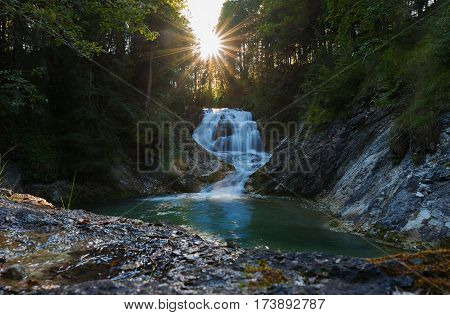 Mountain Creek With Cascade At Sunset