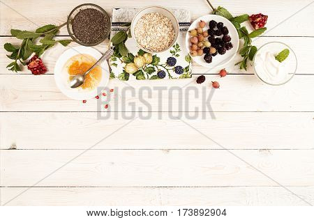 Ingredient For Preparing Healthy Breakfast: Chia, Muesli, Frozen Berries, Yogurt
