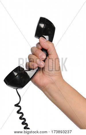 Hand holding vintage telephone isolated over white background
