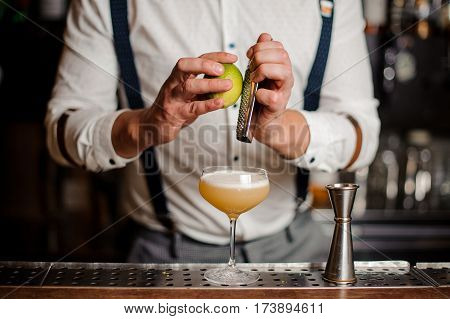 bartender is making a coctail at the bar counter no face