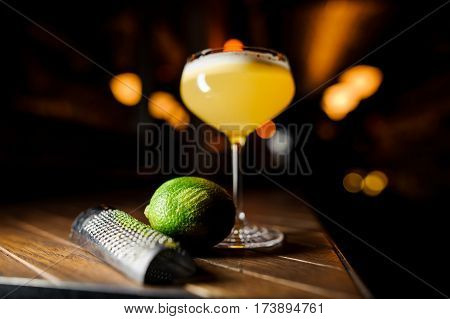 coctail and lime on the brown wooden table