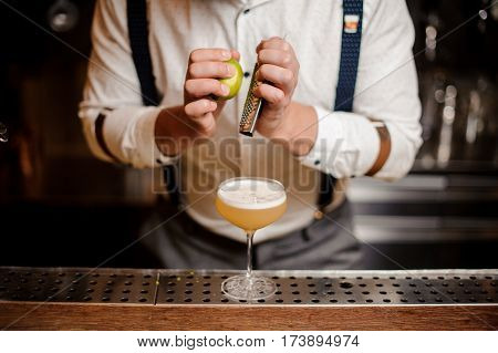 no face close up barman is making a coctail