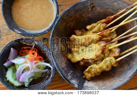 Pork Satay. grilled pork served with peanut sauce or sweet and sour sauce