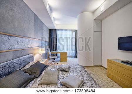 Russia, Moscow - modern designer renovation in a luxury building. Stylish bedroom interior with king sized bed